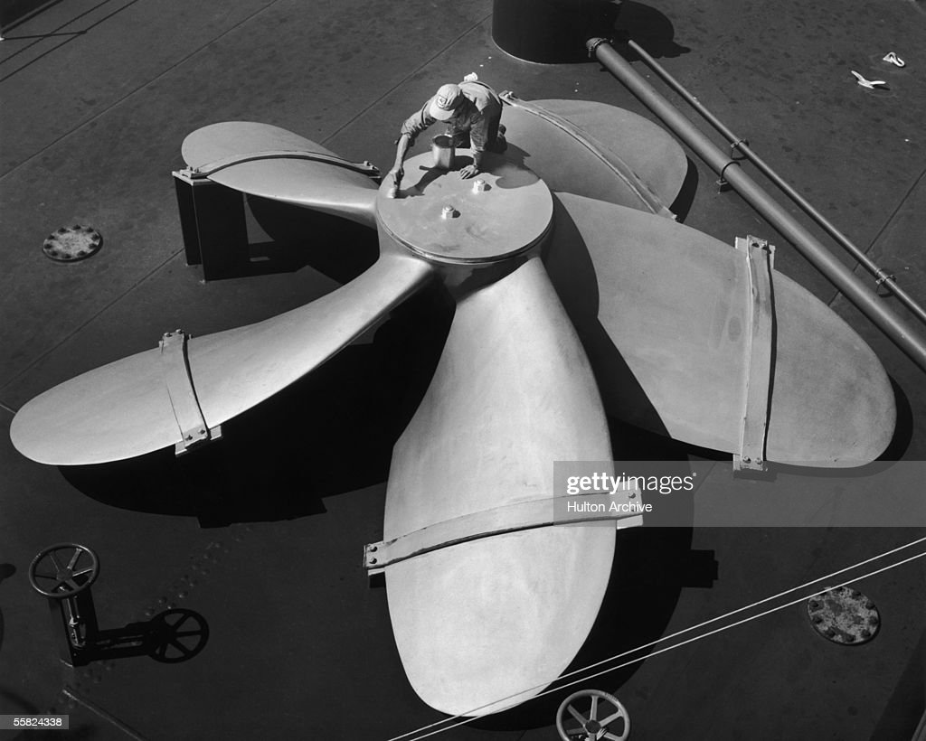 a man painting a huge ship s propeller circa 1950 news photo
