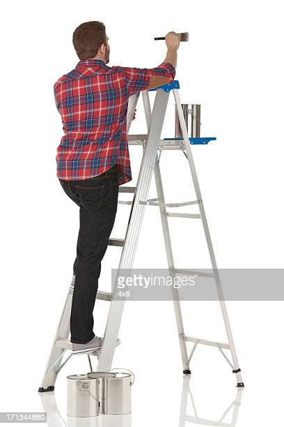 man painting a wall - step ladder stock photos and pictures