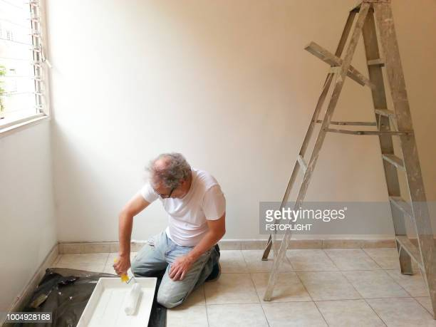Man painting and interior