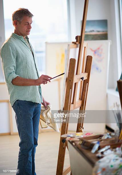 Man painting canvas