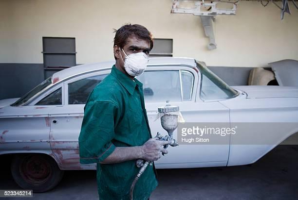 man painting car - hugh sitton bildbanksfoton och bilder