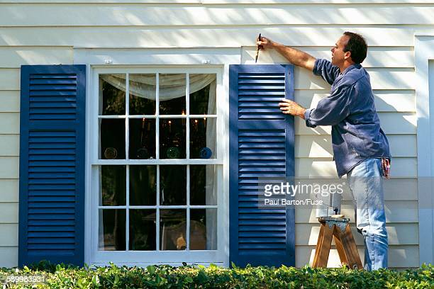 man painting exterior of house - shutter stock pictures, royalty-free photos & images