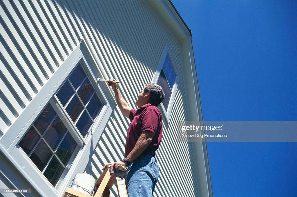 Man Painting House Exterior Low Angle View Stock Photo - Getty Images
