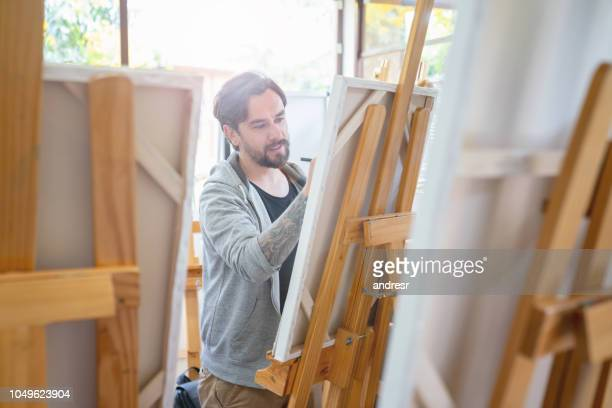 Man painting in an art class