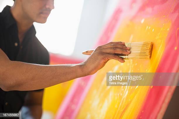 Man painting in studio