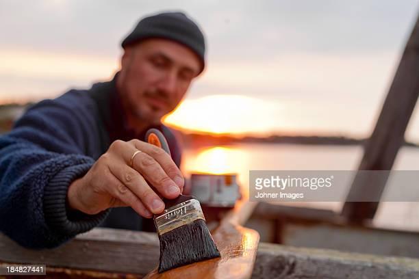 Man painting oar
