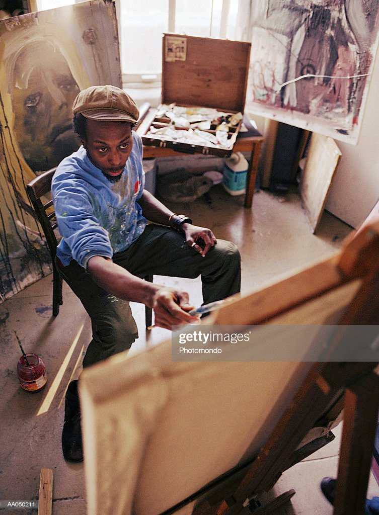 Man painting picture : Stock Photo