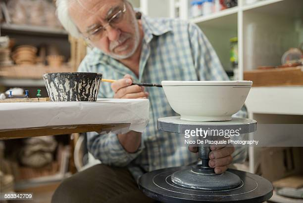 Man painting pottery