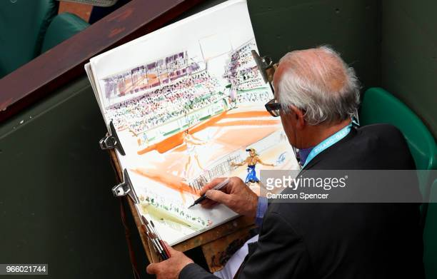 A man paints a picture on centre court during day seven of the 2018 French Open at Roland Garros on June 2 2018 in Paris France