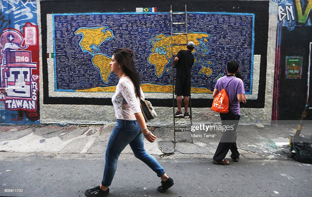 Man paints street art in rio pictures getty images a man paints street art depicting a world map in the lapa neighborhood on september 15 gumiabroncs Choice Image