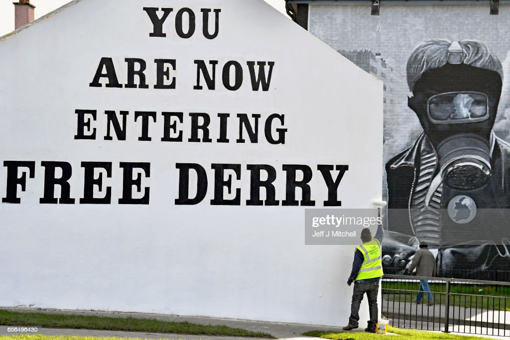 A man paints the 'Free Derry' corner wall in the Bogside ahead of the Funeral of Martin McGuinness, on March 22, 2017 in Belfast, Northern Ireland. Northern Ireland's Former Deputy First Minister Martin McGuinness died overnight on Monday 20th March 2017. He was once chief of staff of the IRA and became Sinn Fein's chief negotiator in the talks that led to the Good Friday agreement bringing peace to Northern Ireland.
