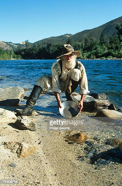 man panning for gold - california gold rush stock photos and pictures