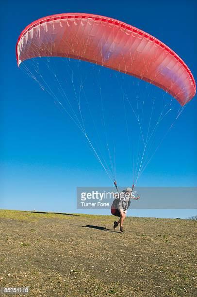 Man paraglides