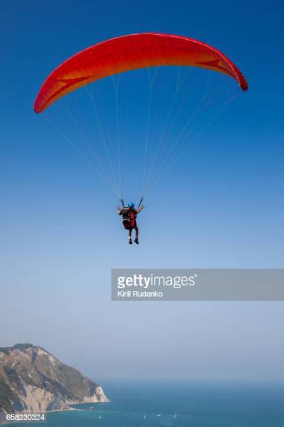 Man paragliding over the Mediterranean Sea