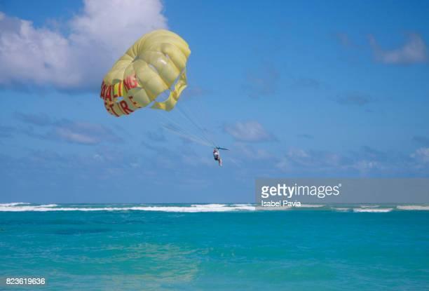 Man Parasailing Over Sea Against Sky
