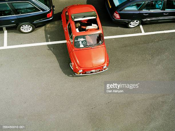 Man parking red car, overhead view