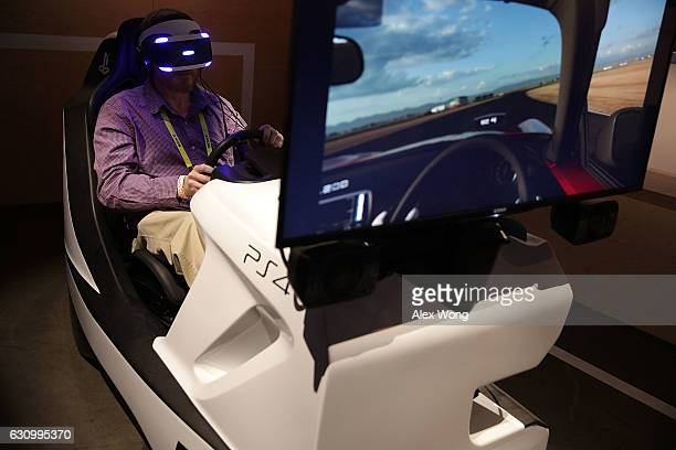 A man participates in a PlayStation GT Sport experience during a press event for CES 2017 at the Las Vegas Convention Center on January 4 2017 in Las...