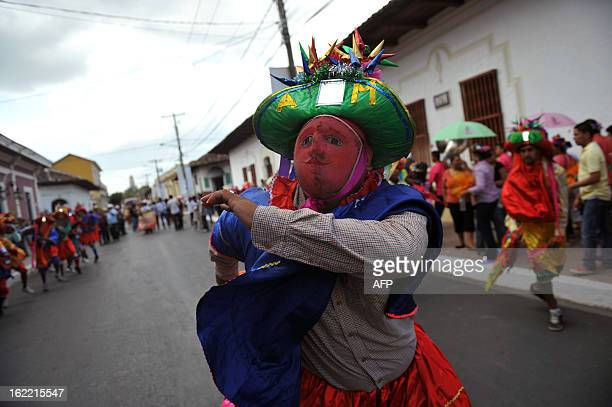 A man participates in the Burial of arrogance and haughtiness carnival during the IX Poetry Festival in Granada 45 km from Managua Nicaragua on...