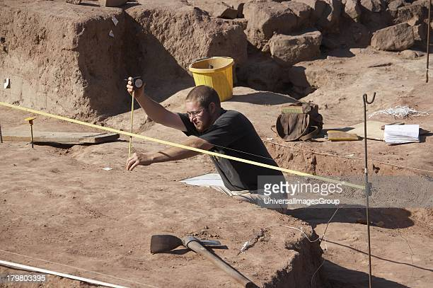 Man participating in live historical archaeological dig in the Amphitheatre City of Chester Cheshire England United Kingdom
