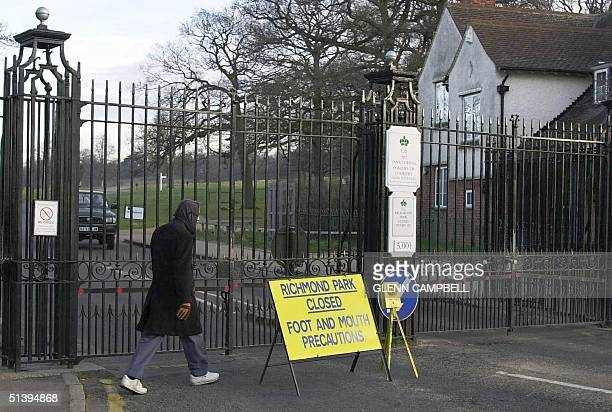 A man pases the closed Kingston gate entrance to Richmond park 26 February 2001As the outbreak of foot and mouth disease spreads around the United...