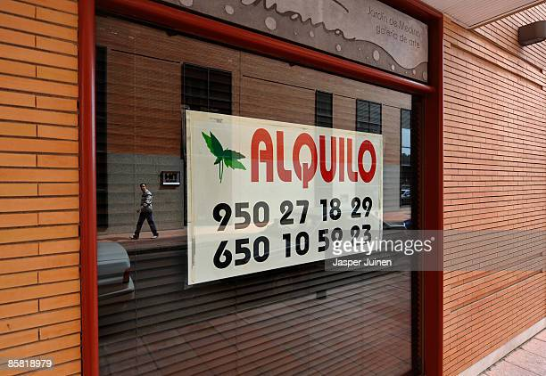 A man passes a closed down restaurant now for rent on April 4 2009 in the coastal town of Almeria southeast Spain Before the real estate bubble burst...
