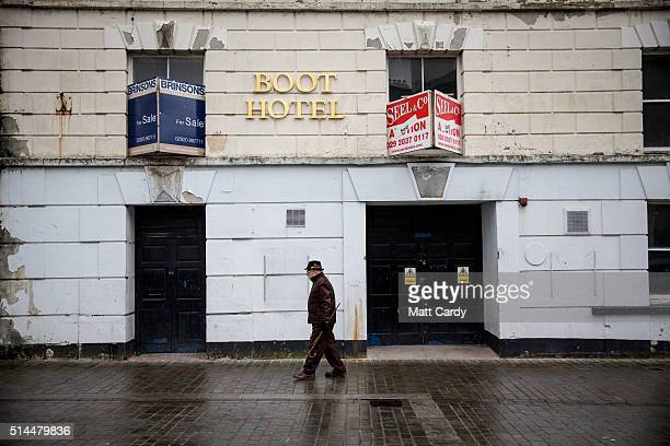 A man passes a empty hotel in Aberdare on March 8 2016 in Rhondda Cynon Taf Wales The West Wales and the Valleys region which covers 15 local...