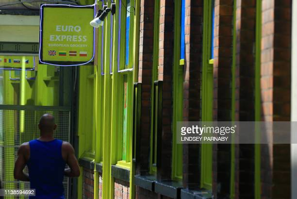 A man passes a European food store in the town of Boston in Lincolnshire northeast England April 18 2019 Boston registered Britain's strongest...