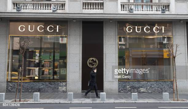 bf1d0d6c85f A man passes a Gucci shop in central Bucharest on February 7 2017 in  Bucharest Romania