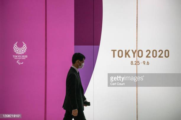 Man passes an advert for the Tokyo 2020 Olympics on March 25, 2020 in Tokyo, Japan. Following yesterday's announcement that the Tokyo 2020 Olympics...