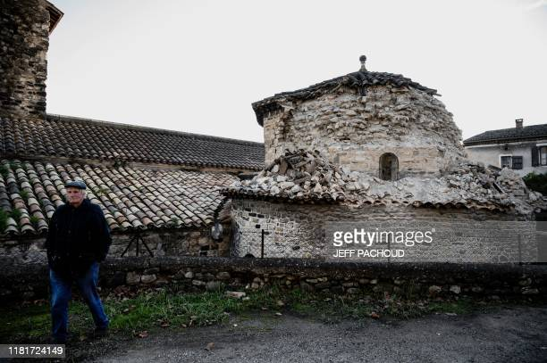 TOPSHOT A man passes by a collapse a church tower in Le Teil southeastern France on November 11 after an earthquake with a magnitude of 54 hit the...