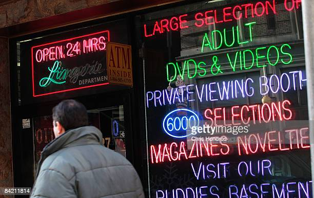 A man passes by an adult video store January 8 2009 in New York According to reports Porn industry leaders Larry Flynt and Joe Francis are asking for...