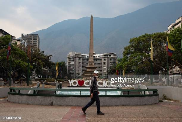 A man passes by empty Altamira Square as a preventive measure against the new type of coronavirus pandemic in Caracas Venezuela on April 02 2020