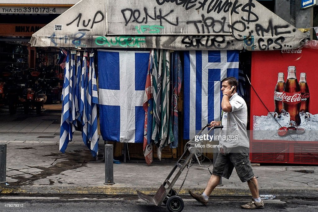 A man passes by Greek flags on June 22, 2015 in Athens, Greece. The European Union welcomed new proposals from the Greek government after talks today to haul Athens back from the brink of bankruptcy.