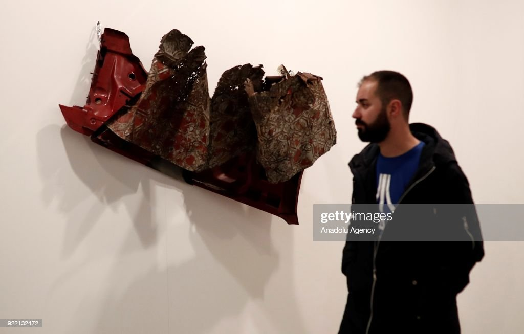 A man passes by in front of an artwork during ARCOmadrid 2018 in Madrid, Spain on February 21, 2018.
