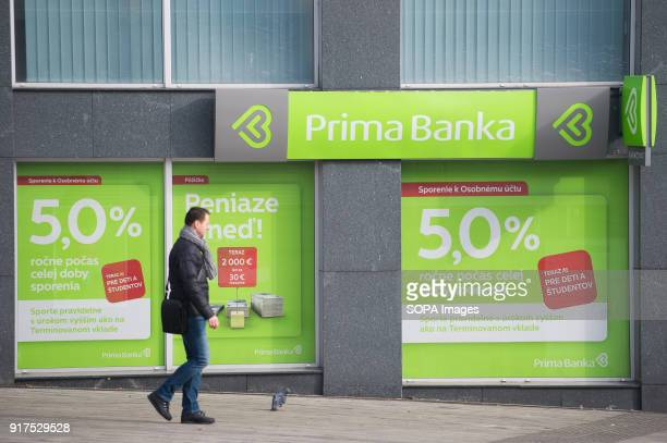A man passes by Prima Banka in Bratislava Bratislava is the capital city of Slovakia it has a population of just over 420000 in late 2017