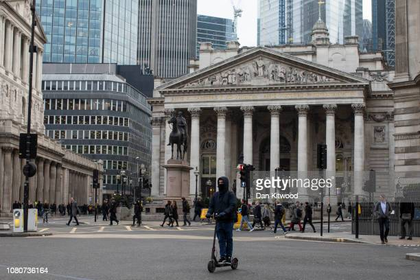 A man passes by the Bank of England on an electric scooter on January 11 2019 in London England In the UK electric scooters and similar powered...