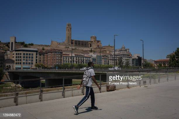 Man passes by the cathedral Seu Valle at the town of Lleida, capital of the Segrià region, on July 6, 2020 in Lleida, Spain. The president of the...