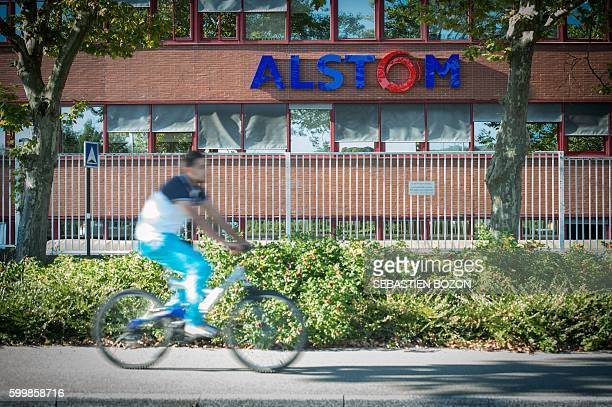 A man passes by the French power and transport engineering company Alstom factory in Belfort eastern France on September 7 2016 French rail transport...