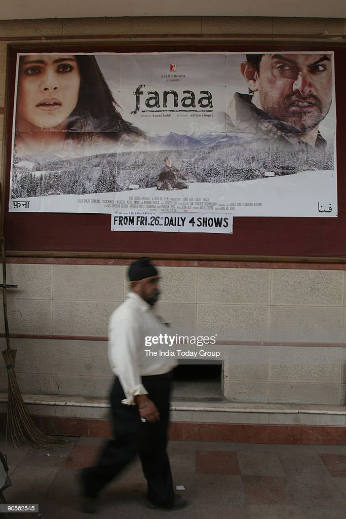 A man passes by the poster of Aamir and Kajol starrer