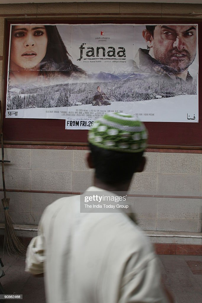 A man passes by the poster of Aamir Khan and Kajol starrer