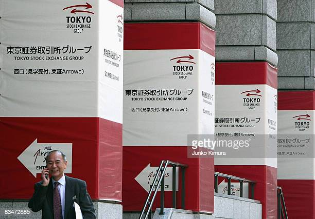 Man passes by the Tokyo Stock Exchange on October 29 2008 in Tokyo Japan Nikkei Index soar above 8000 mark today after sinking below 7000 26year low...