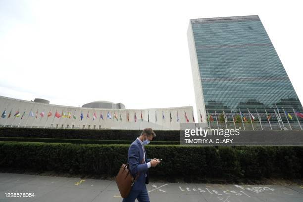 Man passes by the UN headquarters in New York on September 18, 2020. - During the 75th session of the UN General Assembly, Heads of State and...