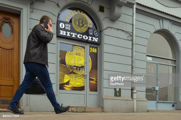 A man passes in front of a Bitcoin exchange shop in Wielopole Street in Krakow's city center On Wednesday April 4 in Krakow Poland