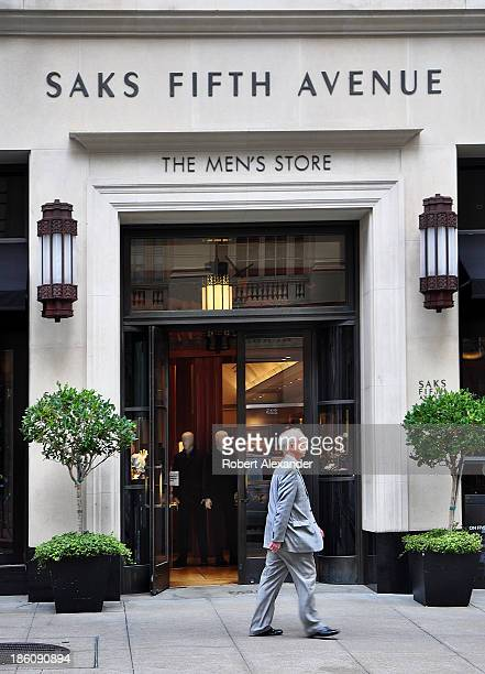 A man passes in front of the Saks Fifth Avenue Men's Store in San Francisco's upscale Union Square shoppping area on September 30 2013 in San...