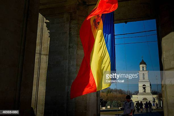 Man passes the Moldovan national flag in front of the cathedral in the Cathedral Park on March 8, 2015 in Chisinau, Moldova. The Republic of Moldova...