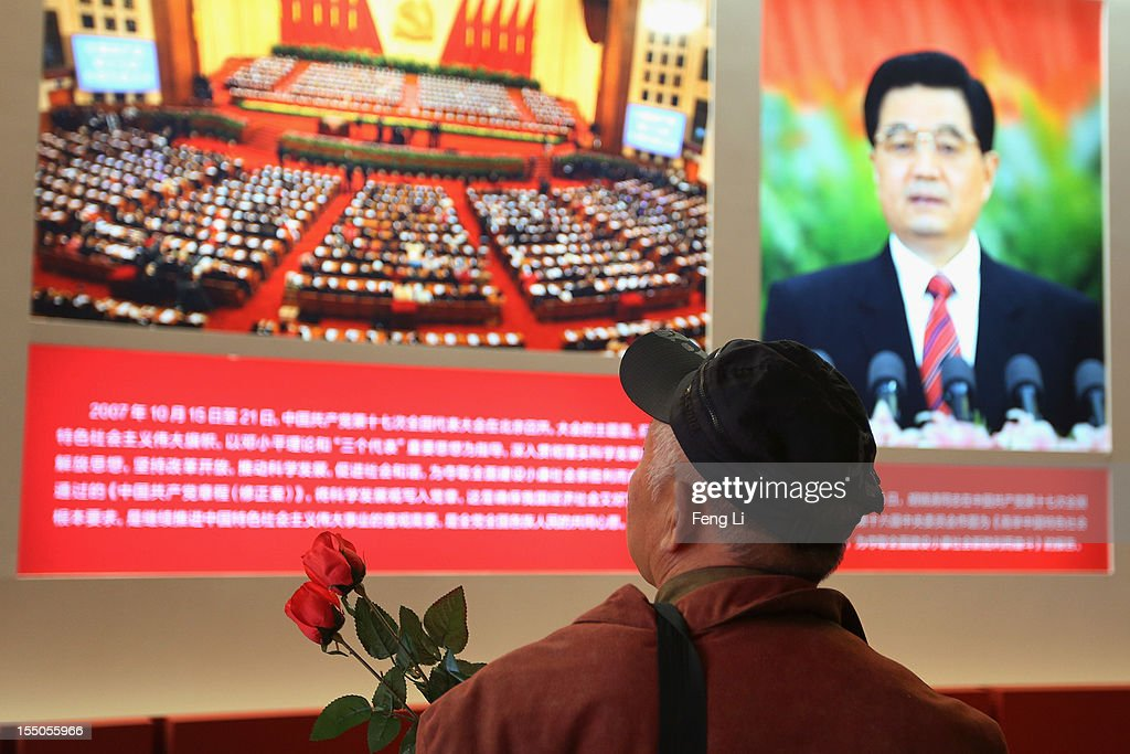 A man passes the picture of China's President Hu Jintao as visiting an exhibition entitled 'Scientific Development and Splendid Achievements' before the18th National Congress of the Communist Party of China (CPC) on October 30, 2012 in Beijing, China. The exhibition showcases China's progress in political, economic, cultural and ecological spheres over the past decade. The18th National Congress of the Communist Party of China (CPC) is proposed to convene on November 8 in Beijing.