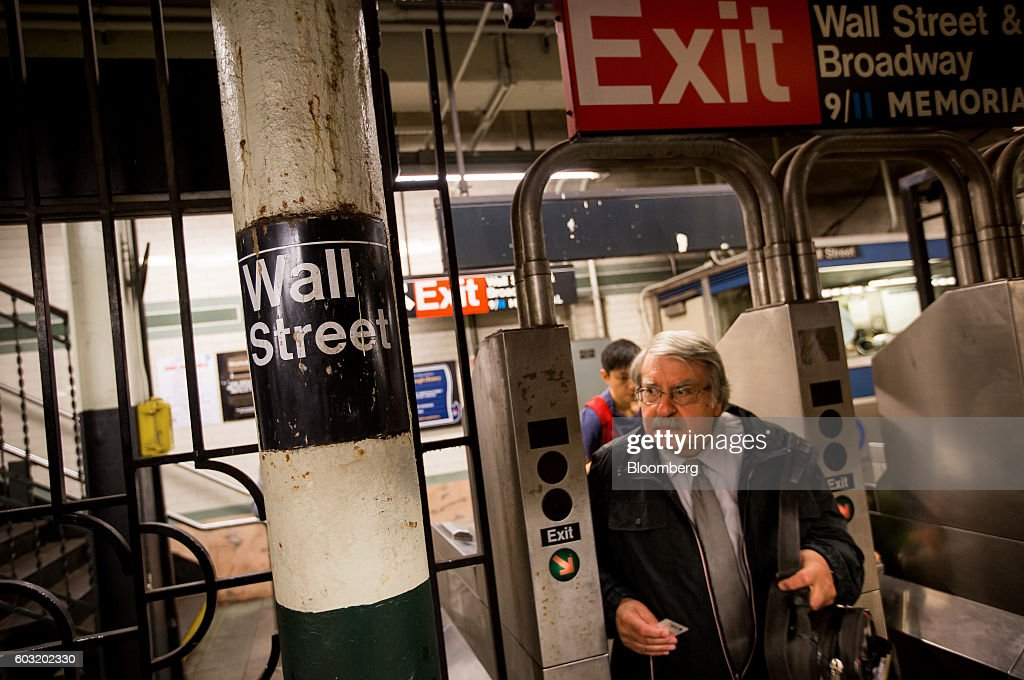 A man passes through a turnstile at the Wall Street subway station near the New York Stock Exchange (NYSE) in New York, U.S., on Monday, Sept. 12, 2016. U.S. stocks rebounded after the biggest rout since June wiped about $500 billion from the value of equities, while Treasury yields held near two-month highs before the Federal Reserve's Lael Brainard official speaks. Emerging-market assets slumped. Photographer: Michael Nagle/Bloomberg via Getty Images