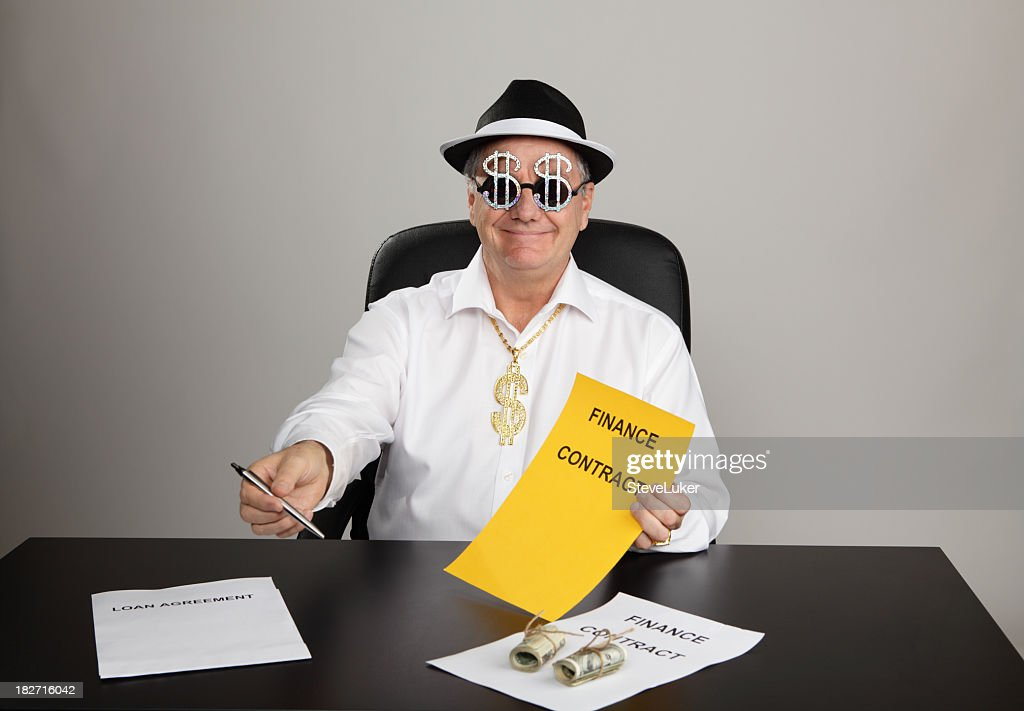 A man passing a pen and signing contract to someone : Stock Photo