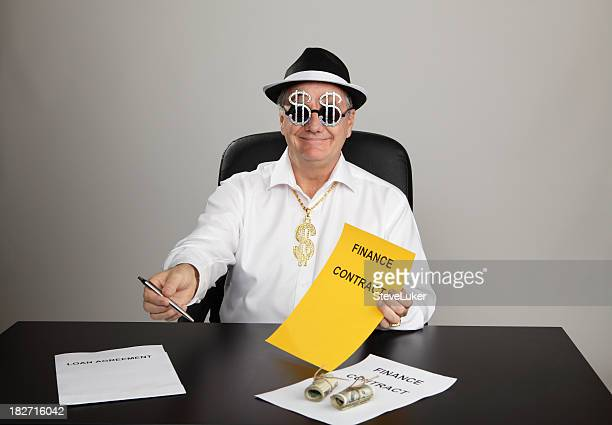 a man passing a pen and signing contract to someone - con man stock photos and pictures