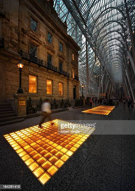 Man passing by in front of the RBC branch inside Lambert Galleria in Toronto